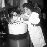 A black and white photo of Dr. Sharon Patton working with parasite sample in the lab.